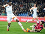 Valenciennes' French midfielder Tongo Hamed Doumbia vies for the ball with Montpellier's French goalkeeper Geoffrey Jourdren during the French L1 football match Montpellier vs Valenciennes on March 29, 2014