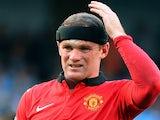 Wayne Rooney looks dejected against Manchester City on September 22, 2013.