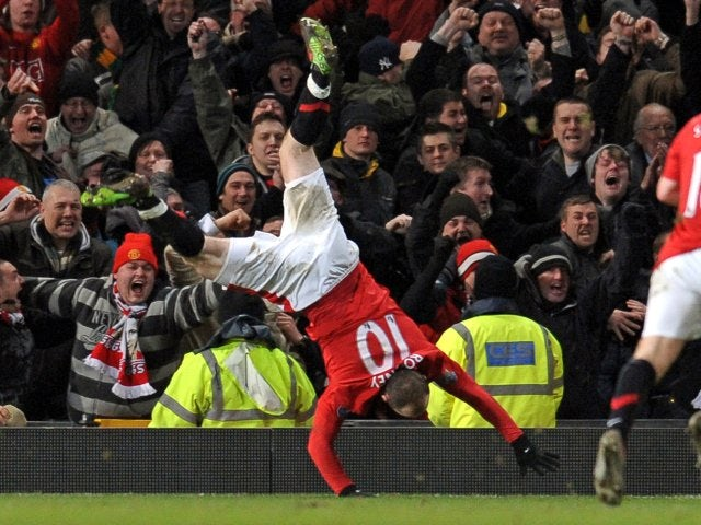 Wayne Rooney celebrates scoring for Manchester United against Manchester City on January 27, 2010.