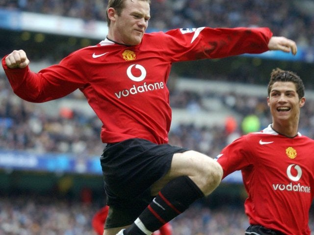 Wayne Rooney celebrates scoring for Manchester United against Manchester City on February 13, 2005.