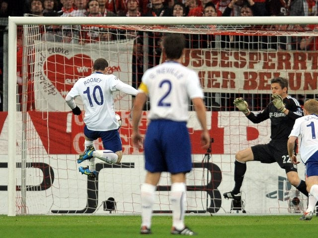 Manchester United's Wayne Rooney scores against Bayern Munich on March 30, 2010.