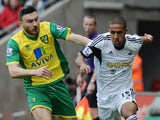 Wayne Routledge of Swansea City is closed down by Robert Snodgrass of Norwich City during the Barclays Premier League match on March 29, 2014