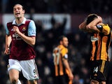 West Ham United's English striker Andy Carroll celebrates celebrates scoring his team's second goal during the English Premier League football match between West Ham United and Hull City at the Boleyn Ground, Upton Park, in East London, England, on March