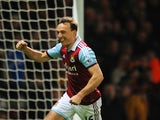 Mark Noble of West Ham celebrates scoring the opening goal from the penalty spot during the Barclays Premier League match between West Ham United and Hull City at Boleyn Ground on March 26, 2014