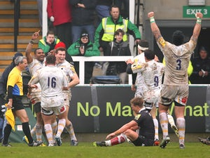 Josh Drauniniu of Worcester celebrates with team mates after scoring a try during the Aviva Premiership match between Newcastle Falcons and Worcester Warriors at Kingston Park on March 30, 2014