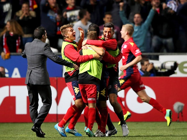 United players celebrate during the round 26 A-League match between Adelaide United and Melbourne Heart at Coopers Stadium on April 4, 2014