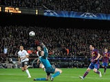 Barcelona's Argentinian forward Lionel Messi chips the ball over Arsenal's Spanish goalkeeper Manuel Almunia to score his hat-trick during the Champions League quarter-final second-leg match at Camp Nou stadium in Barcelona on April 6, 2010