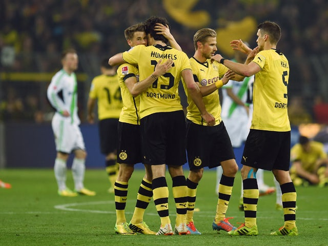 Dortmund�s players celebrate after the German first division Bundesliga football match Borussia Dortmund vs VfL Wolfsburg in Dortmund, western Germany, on April 5, 2014