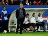 A dejected Jose Mourinho the Chelsea manager looks on as his team head towards a 3-1 defeat during the UEFA Champions League quarter final, first leg match between Paris Saint Germain and Chelsea at Parc des Princes on April 2, 2014