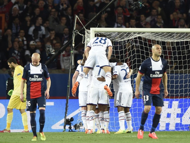 Chelsea's players celebrate after scoring during the UEFA Champions League quarter-final first leg football match Paris Saint-Germain vs Chelsea, on April 2, 2014