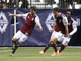 Marc Burch #4 and Charles Eloundou #19 celebrate with Jose Marin #6 of the Colorado Rapids who scored two goals against the Vancouver Whitecaps FC during their MLS game April 5, 2014