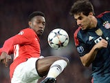Manchester United's English striker Danny Welbeck (2R) controls the ball during the UEFA Champions League quarter-final first leg football match against Bayern Munich on April 1, 2014
