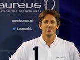 Edwin van der Sar OON poses near the Laureus logo during the Laureus Family Event held at Indoor-Sportcentrum on November 27, 2013