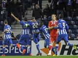 Porto's French defender Eliaquim Mangala (3L) celebrates with teammates after scoring a goal during the UEFA Europa League quarter-finals first leg football match against Sevilla FC on April 3, 2014
