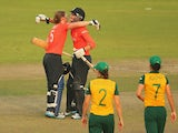 Heather Knight and Sarah Taylor of England celebrate winning the ICC Women's World Twenty20 Bangladesh 2014 2nd Semi-Final match between England Women and South Africa Women at Sher-e-Bangla Mirpur Stadium on April 4, 2014