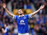 Kevin Mirallas of Everton celebrates scoring the third goal during the Barclays Premier League match between Everton and Arsenal at Goodison Park on April 6, 2014