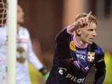 Evian's Danish defender Daniel Wass celebrates after scoring a goal during the French L1 football match between Lorient and Evian on April 05, 2014