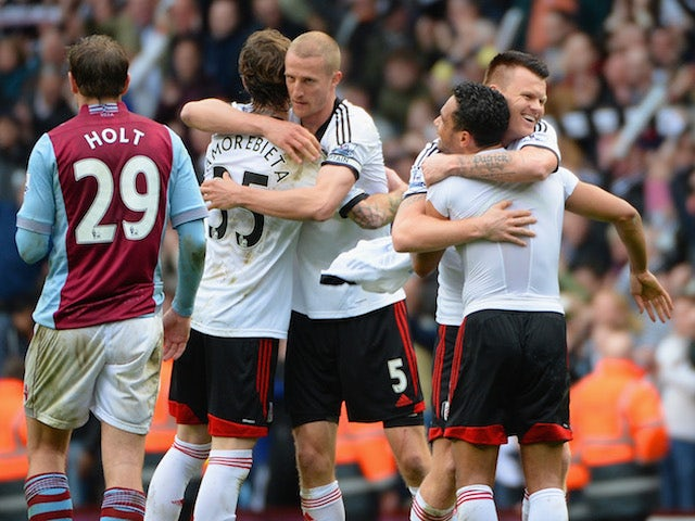 Fernando Amorebieta, Brede Hangeland, John Arne Riise and Kieran Richardson of Fulham celebrate at the end of the match against Aston Villa on April 5, 2014
