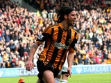 George Boyd of Hull City celebrates after scoring the opening goal with a header during the Barclays Premier league match between Hull City and Swansea City at KC Stadium on April 5, 2014