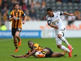 Hull City's Maynor Figueroa and Swansea City's Jonathan de Guzman compete or the ball during the Barclays Premier League match between Hull City and Swansea City at KC Stadium on April 5, 2014