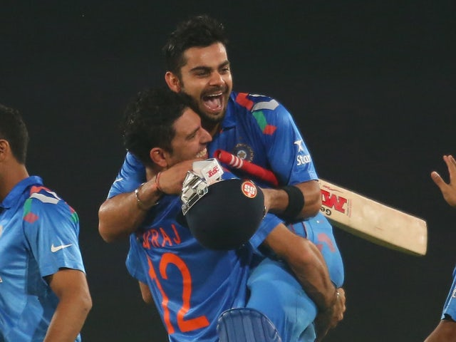 Virat Kohli of India is hugged by Yuvraj Singh after he hit the winning runs as India won the ICC World Twenty20 Bangladesh 2014 2nd Semi-Final match between India and South Africa at Sher-e-Bangla Mirpur Stadium on April 4, 2014