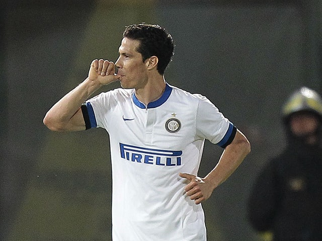 Hernanes of FC Internazionale Milano celebrates after scoring a goal during the Serie A match between AS Livorno Calcio and FC Internazionale Milano at Stadio Armando Picchi on March 31, 2014