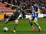 James McArthur (R) of Wigan Athletic in action with Andy King of Leicester City during the Sky Bet Championship match on April 1, 2014