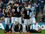 Jay Rodriguez of Southampton goes down injured after landing awkwardly during the Barclays Premier League match against Manchester City on April 5, 2014
