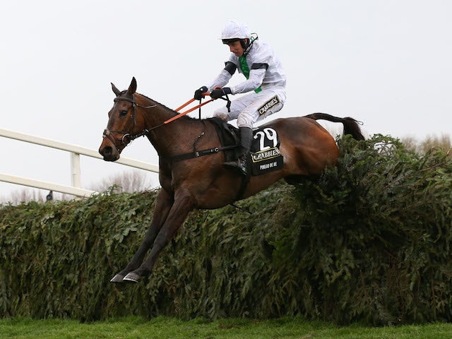 Leighton Aspell riding Pineau De Re jumps the last fence to win the Crabbie's Grand National Chase at Aintree racecourse on April 05, 2014