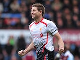 Liverpool's English midfielder Steven Gerrard celebrates after scoring the opening goal from a penalty during the English Premier League football match between West Ham United and Liverpool at Upton Park in London on April 6, 2014