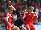 Marouane Chamakh of Crystal Palace battles for the ball with Luke Shaw (L) and James Ward-Prowse (R) of Southampton during a game on September 24, 2013