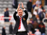 David Moyes manager of Manchester United applauds the fans during the Barclays Premier League match between Newcastle United and Manchester United at St James' Park on April 5, 2014