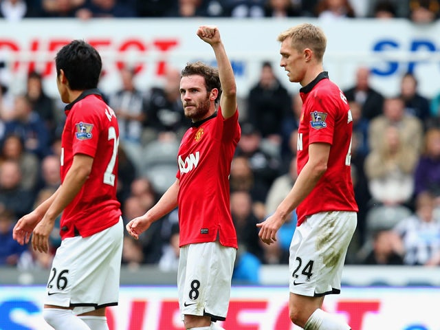 Juan Mata of Manchester United celebrates scoring the opening goal during the Barclays Premier League match between Newcastle United and Manchester United at St James' Park on April 5, 2014