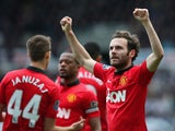 Juan Mata of Manchester United celebrates scoring their second goal during the Barclays Premier League match between Newcastle United and Manchester United at St James' Park on April 5, 2014