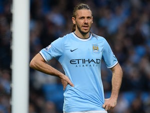 Manchester City's Argentinian defender Martin Demichelis reacts during the English FA Cup quarter-final football match between Manchester City and Wigan Athletic at the Etihad Stadium in Manchester, northwest England, on March 9, 2014