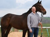 Owen Mike Tindall stands with Monbeg Dude on March 26, 2014.