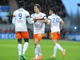 Montpellier's French defender Benjamin Stambouli is congratulated by teammate M'Baye Niang after scoring during the French L1 football match Guingamp against Montpellier on April 5, 2014