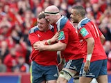 Paul O'Connell of Munster is congratulated by Dave Kilcoyne (left) and Simon Zebo after scoring the last try for Munster during the Heineken Cup Quarter Final match between Munster and Toulouse at Thomond Park on April 5, 2014