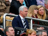 Alan Pardew manager of Newcastle United looks on fromthge stands during the Barclays Premier League match between Newcastle United and Manchester United at St James' Park on April 5, 2014