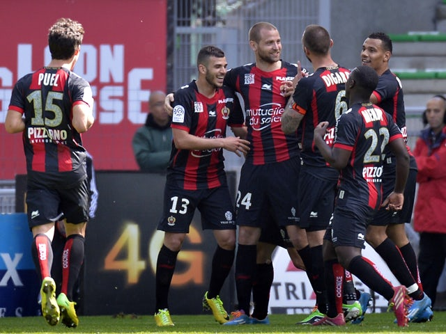 Nice's French midfielder Mathieu Bodmer is congratulated by his teammates after scoring a goal during the French L1 football match Saint-Etienne (ASSE) vs Nice (OGC) on April 6, 2014