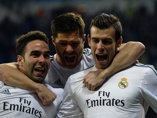 Real Madrid's Welsh forward Gareth Bale after scoring during the UEFA Champions League quarterfinal first leg football match Real Madrid FC vs Borussia Dortmund at the Santiago Bernabeu stadium in Madrid on April 2, 2014