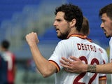 AS Roma's forward Mattia Destro celebrates after scoring a goal during the Italian Serie A football match between Cagliari vs AS Roma on April 6, 2014