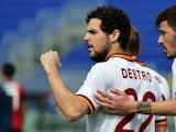 AS Roma's forward Mattia Destro celebrates after scoring a goal during the Italian Serie A football match between Cagliari vs AS Roma on April 6, 2014
