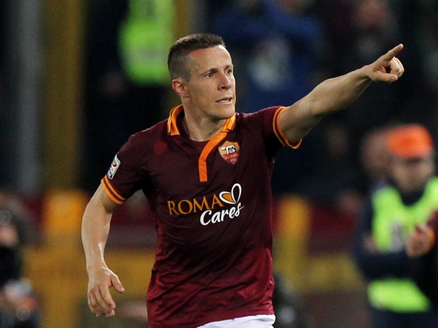 Rodrigo Taddei of AS Roma celebrates after scoring the fourth team's goal during the Serie A match between AS Roma and FC Parma at Olimpico Stadium on April 2, 2014