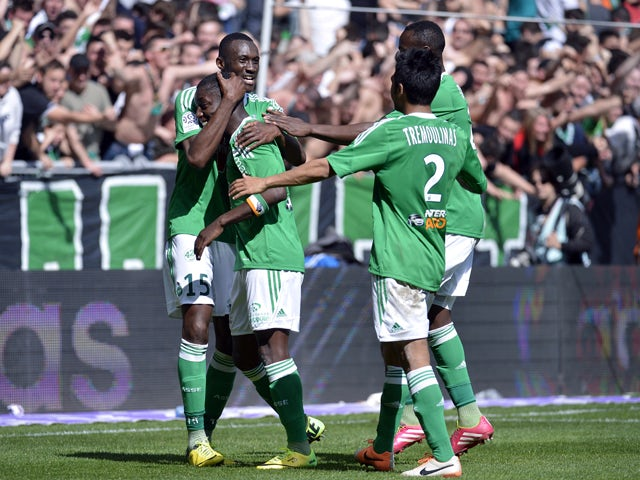 St Etienne's Ivorian forward Max-Alain Gradel is congratulated by his teammates Josuha Guilavogui (L) after scoring a goal during the French L1 football match Saint-Etienne (ASSE) vs Nice (OGC) on April 6, 2014