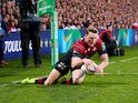 Chris Ashton of Saracens dives over to score a try during the Heineken Cup Quarter-Final match between Ulster and Saracens at Ravenhill on April 5, 2014