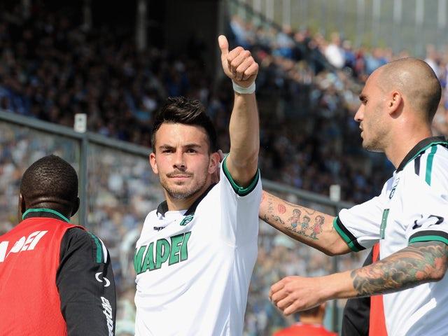 Nicola Sansone of US Sassuolo Calcio celebrates scoring the first goal during the Serie A match between Atalanta BC and US Sassuolo Calcio at Stadio Atleti Azzurri d'Italia on April 6, 2014