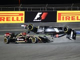 Sauber driver Esteban Gutierrez of Mexico crashes ahead of Lotus driver Pastor Maldonado of Venezuela during the Formula One Bahrain Grand Prix at Sakhir circuit in Manama on April 6, 2014