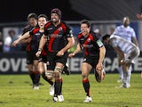 Edinburgh Rugby's Sean Cox and team-mates celebrate their victory after deafeating Racing Metro 92 during their European Cup rugby union match at the Yves du Manoir Stadium in Colombes, northwest of Paris, on January 13, 2012