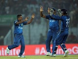 Sri Lanka bowlers Rangana Herath celebrates the wicket of New Zealand batsman Trent Boult with teammates during the ICC World Twenty20 tournament cricket match between New Zealand and Sri Lanka at The Zahur Ahmed Chowdhury Stadium in Chittagong on March 3